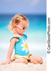 Little girl at tropical beach - Adorable toddler girl at...