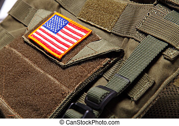 American flag on bulletproof vest - American flag on a green...