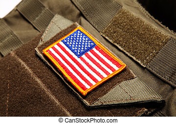 American flag on tactical vest - American flag on a green...