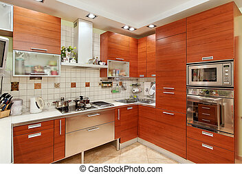 Kitchen interior with wooden furniture and build in utensils...