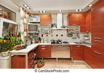 Kitchen interior with wooden furniture and many utensils in...