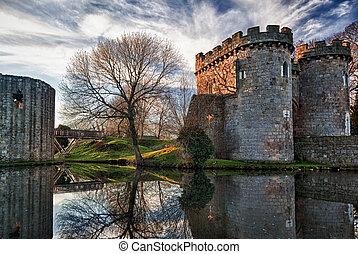 Whittington Castle in Shropshire reflecting on moat -...