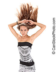 Young beautiful woman with long hairs flying upwards