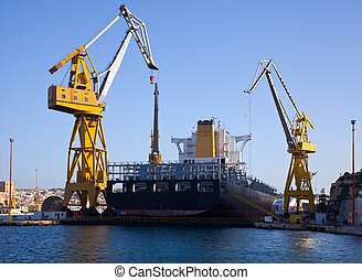 Big ship in dry dock - Ship in dry dock at Grand harbour...