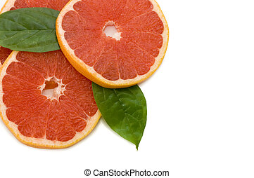 Fresh juicy grapefruits with green leafs