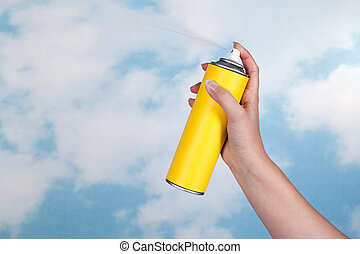 Spraying poison in the air - Hand spraying a substance like...