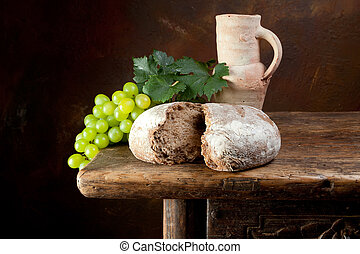 Wine jug with rustic bread - Antique wine jug with grapes...