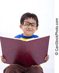 Happy young asian boy with book