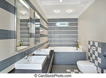Modern bathroom in blue and gray tones with mosaic on wide...