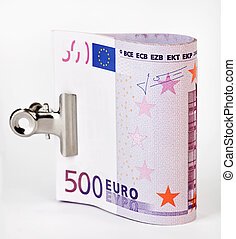 Bundle of 500 Euro bank notes fasten with paper clip