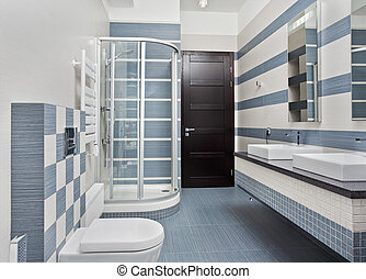 Modern bathroom in blue and gray tones with shower cubicle