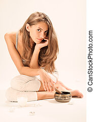 Sitting young beautiful woman SPA relaxing in studio on...