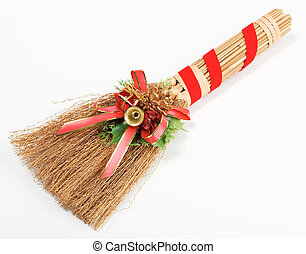 Christmas broom decorations isolated on white