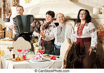 Ukrainian ethnic music band concert in traditional...