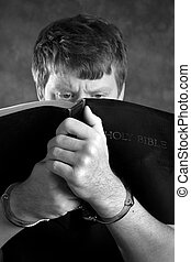 Prison Religion - Prisoner finds comfort by studying the...