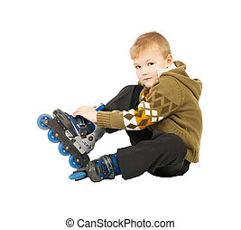 little beautiful baby boy on roller skates