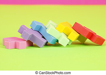 All Fall Down - Colorful eraser puzzle pieces in a row...