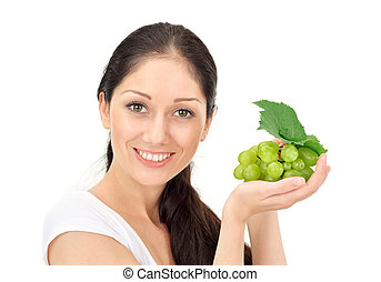 Young attractive woman with green grape cluster isolated on...