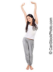 Young beautiful brunette lady stretching after awaking