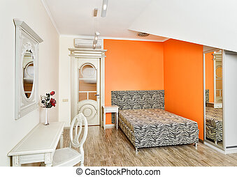 Modern bedroom in bright orange colors with zebra patterned...