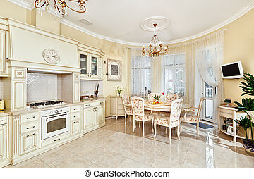 Classic style kitchen and dining room interior in beige...