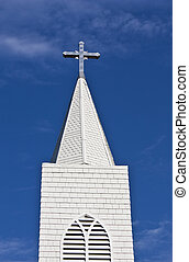 Church Steeple - Looking up at a church steeple and cross