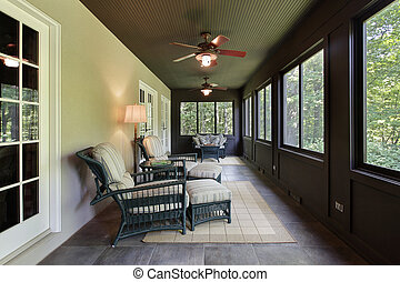 Porch with dark wood paneling - Porch in luxury home with...