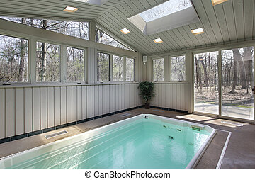 Small lap pool with skylights