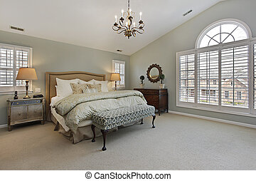 Master bedroom with circular window - Master bedroom in...
