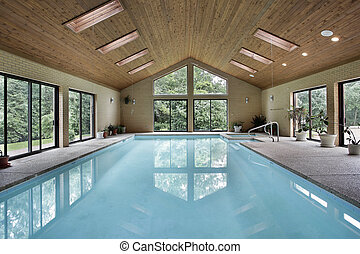 Indoor pool with skylights - Indoor pool in luxury home with...