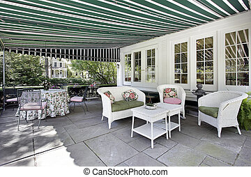 Patio with green awning - Patio in luxury home with green...