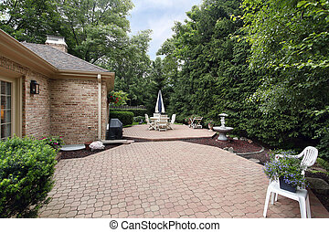 Brick patio with rock garden and fountain