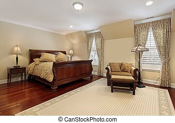 Master bedroom with cherry wood flooring - Master bedroom in...
