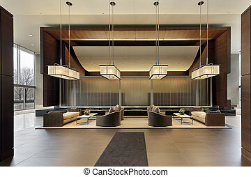 Lobby of high rise building with seating area