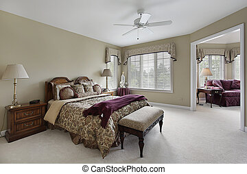 Master bedroom with adjacent sitting room