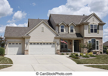 Home with three car garage - Home with covered entry and...