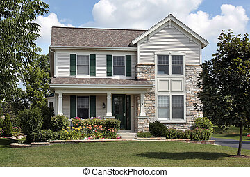 Home with green shutters - Home with stone front and green...