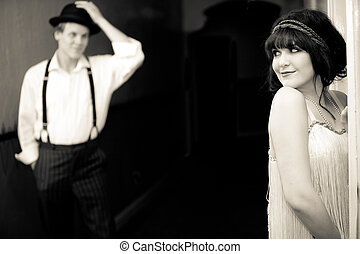 Young Flapper Girl flirting with young man outside hotel...