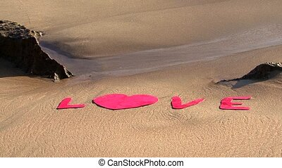 love letters on beach washed away - V50love in red between...