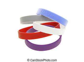 Color wrist bands - A stack of color wrist bands on white...