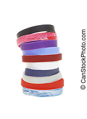 Stack of colorful wrist bands on white background