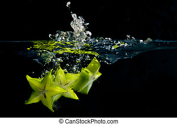 Falling Stars - A trio of star fruit pieces create a splash...