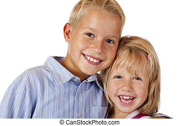 Boy and girl are smiling happy into camera. Isolated on white background.