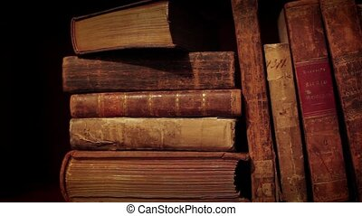 Old books - Ancient books in a bookshelf Pan from left to...