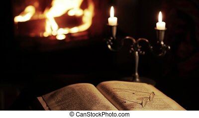 Fireplace and an old bible - Stillife of a fireplace,...