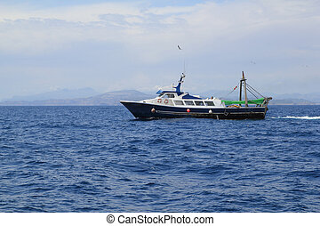 fishing trawler professional boat working in blue ocean sea