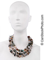 Colorful necklace on a mannequin isolated on white