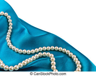 Pearl beads on the blue silk cloth