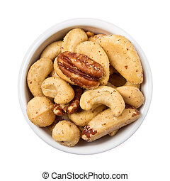 Mixed Salted Nuts in bowl overhead view isolated on white.