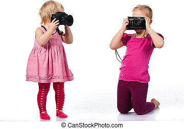 Children playing as photographers isolated on white
